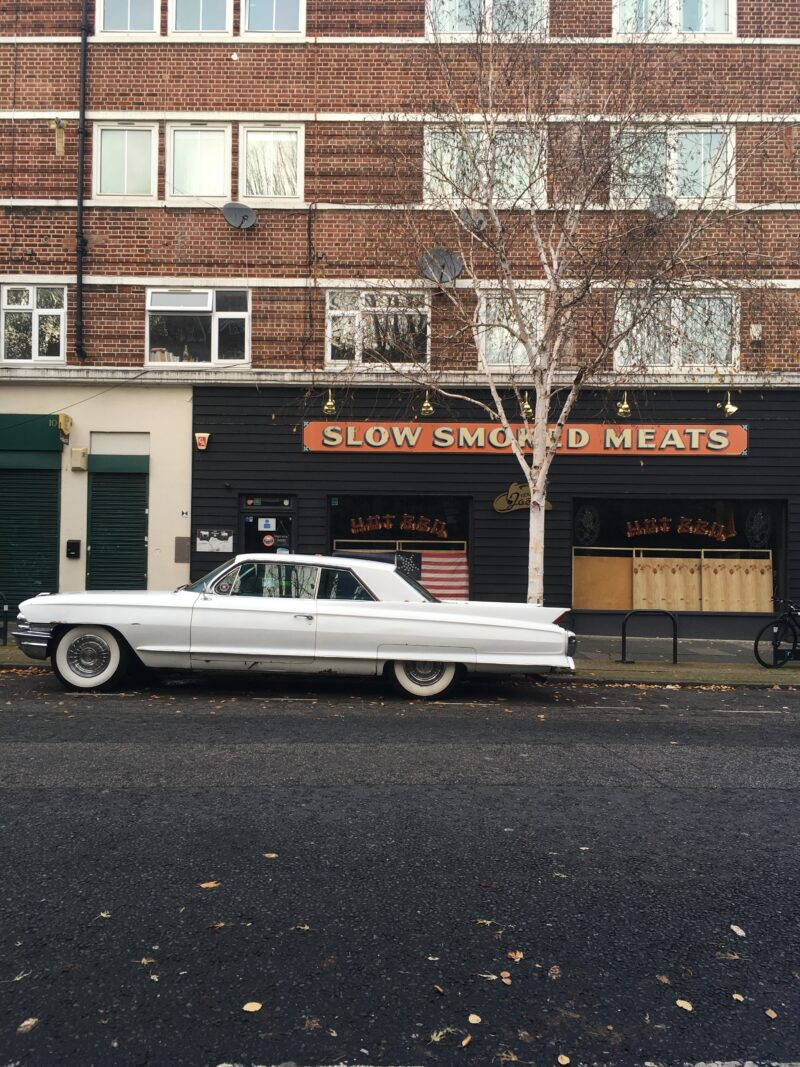 A beautiful vintage American car outside a restaurant at the back of London Bridge station.
