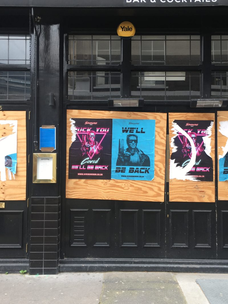 Posters on doors of an empty pub in North London
